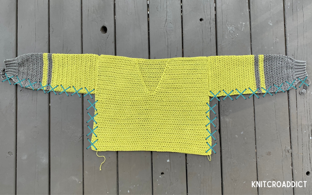 simple crochet hoodie free pattern and photo tutorial demonstrating how to sew the side seams