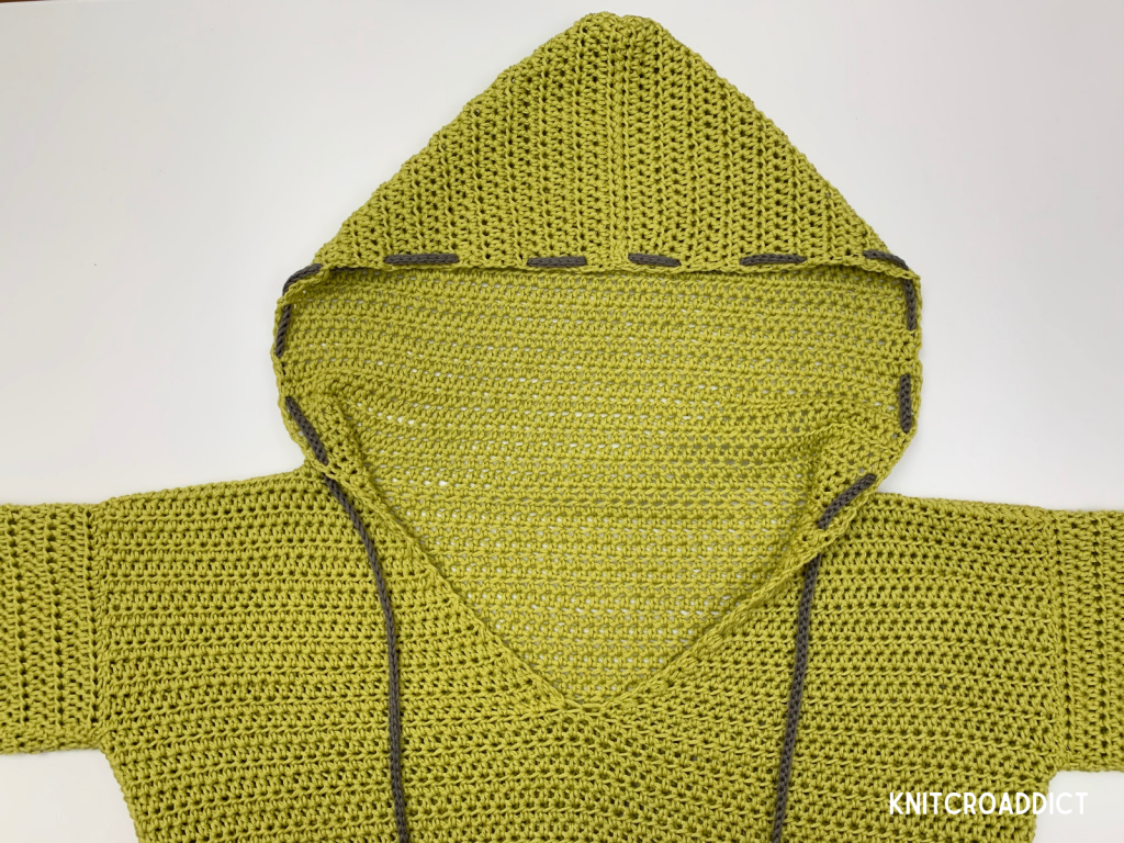 Simple crochet hoodie design by knitcroaddict finished project on display