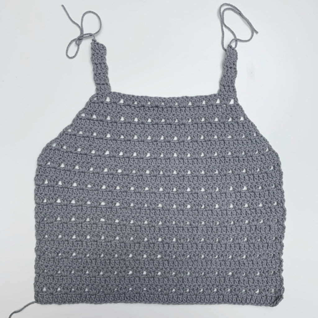 crochet halter top front panel with tail still attached from step by step photo tutorial on knitcroaddict