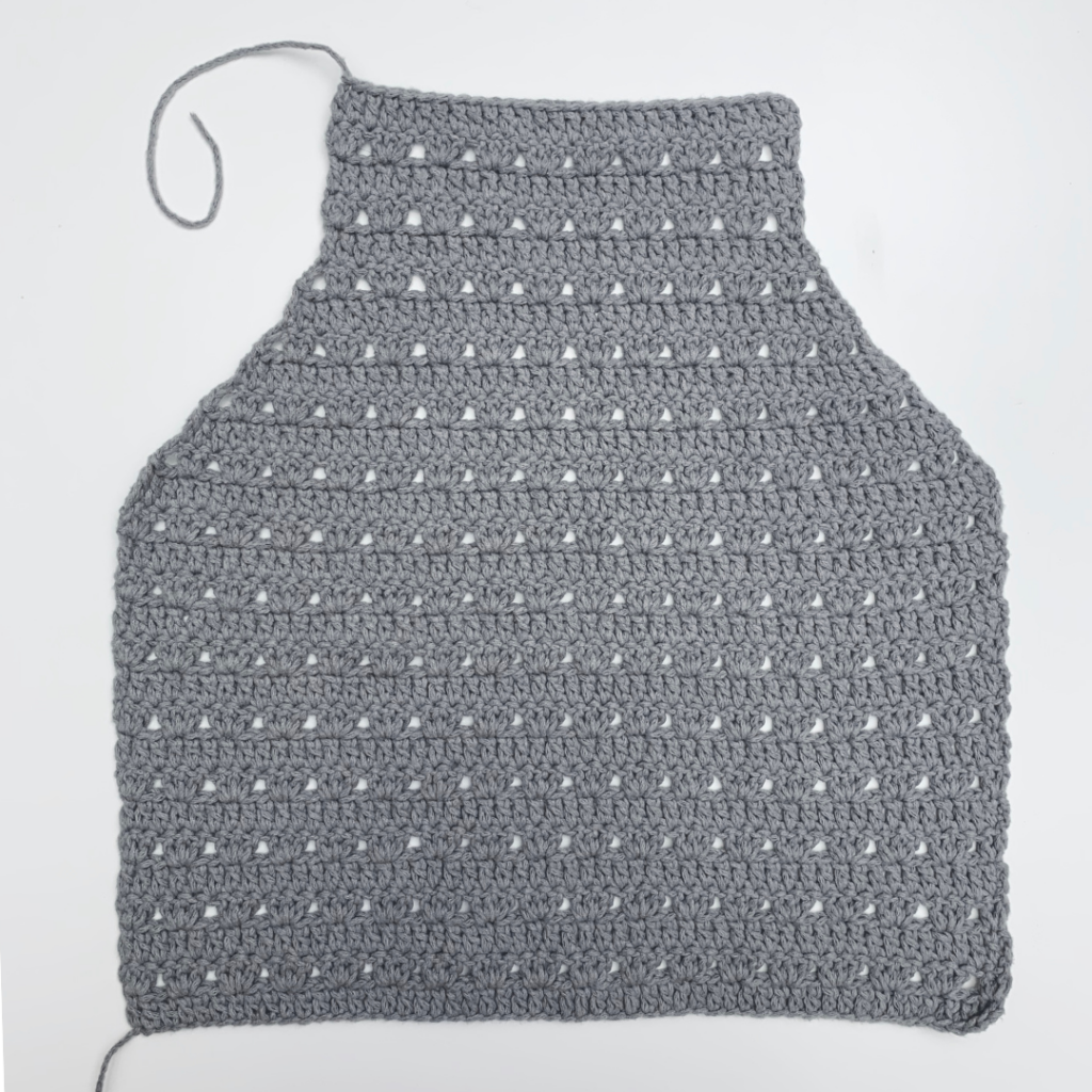crochet halter top back panel with tail still attached from step by step photo tutorial on knitcroaddict