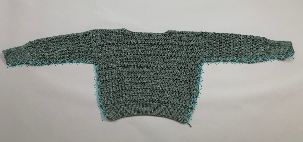 Easy crochet sweater pattern step by step photo tutorial joining all the panels and sleeves and sewing the side seams