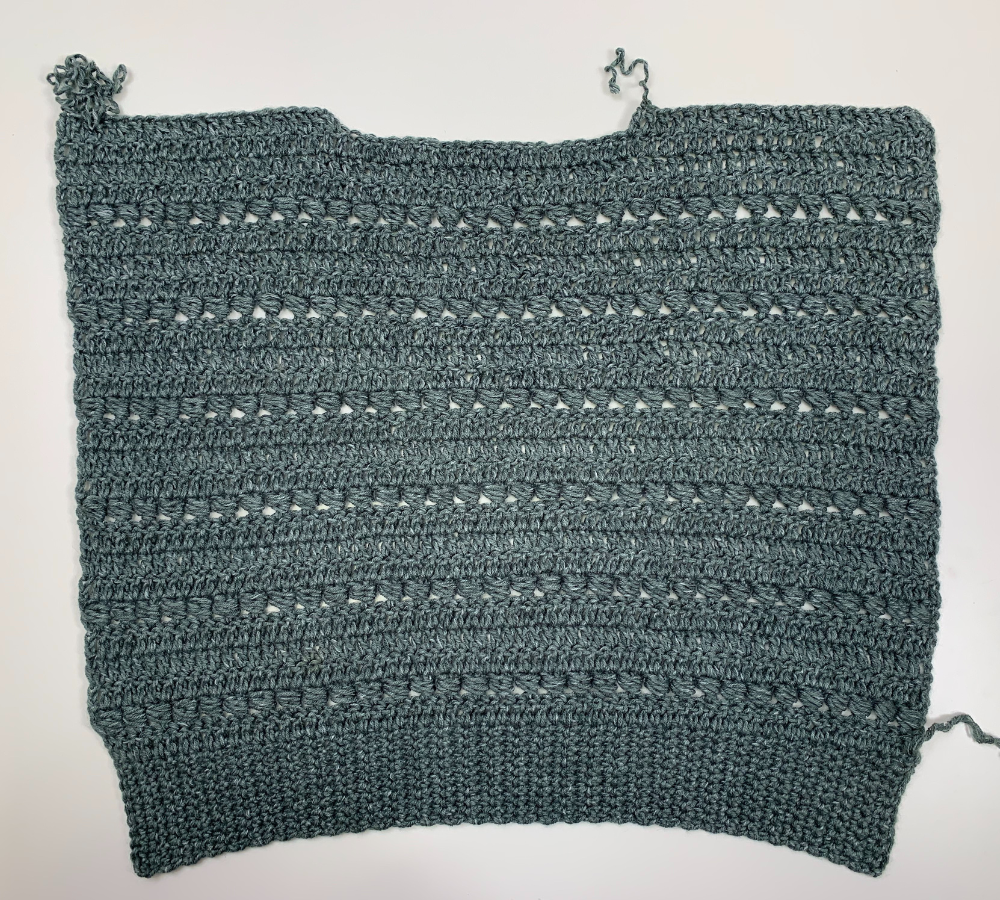 Easy crochet sweater pattern step by step photo tutorial by knitcroaddict finishing the first panel
