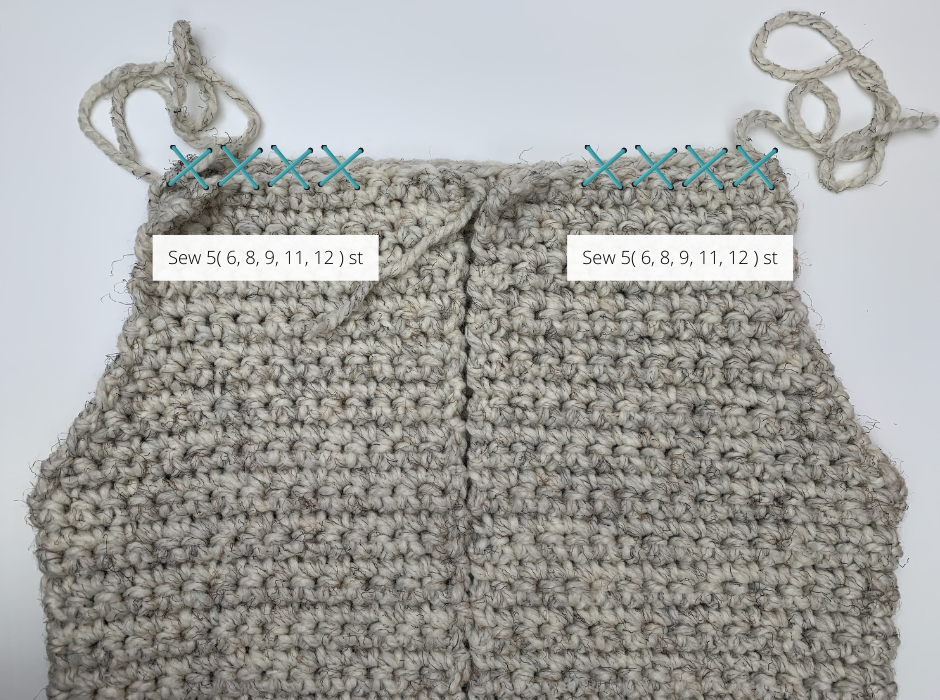 sewing the shoulders together on this hooded crochet sweater vest