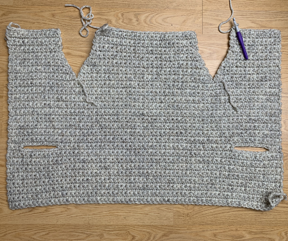 upper back of the crochet sweater vest panel finished