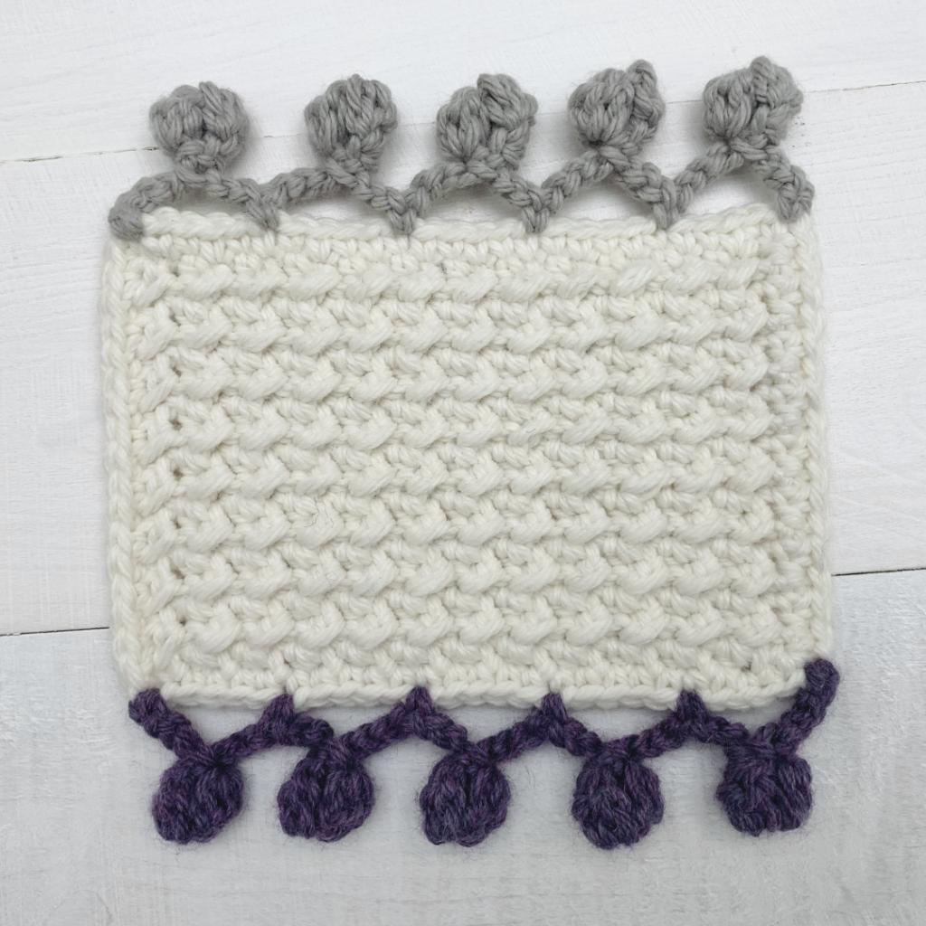 finished piece with crochet pom pom border