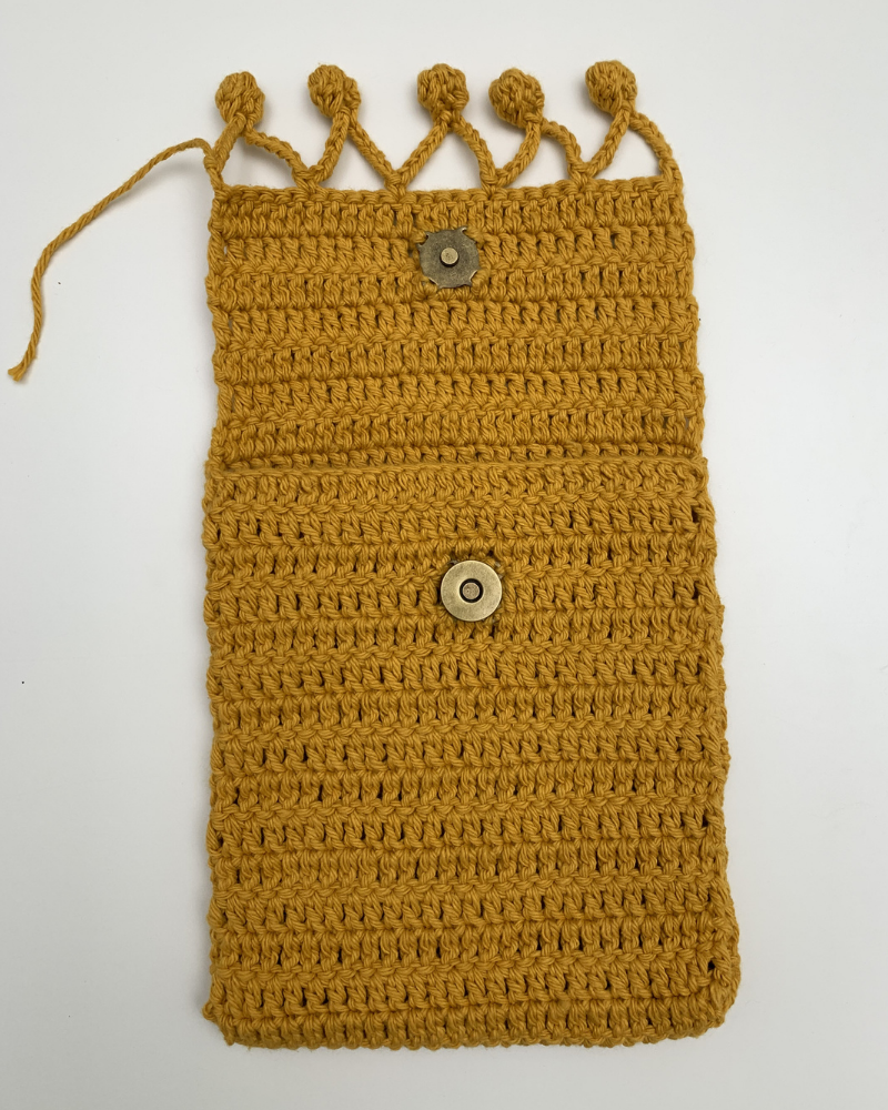 instructions for adding the snaps into your crochet pouch pattern
