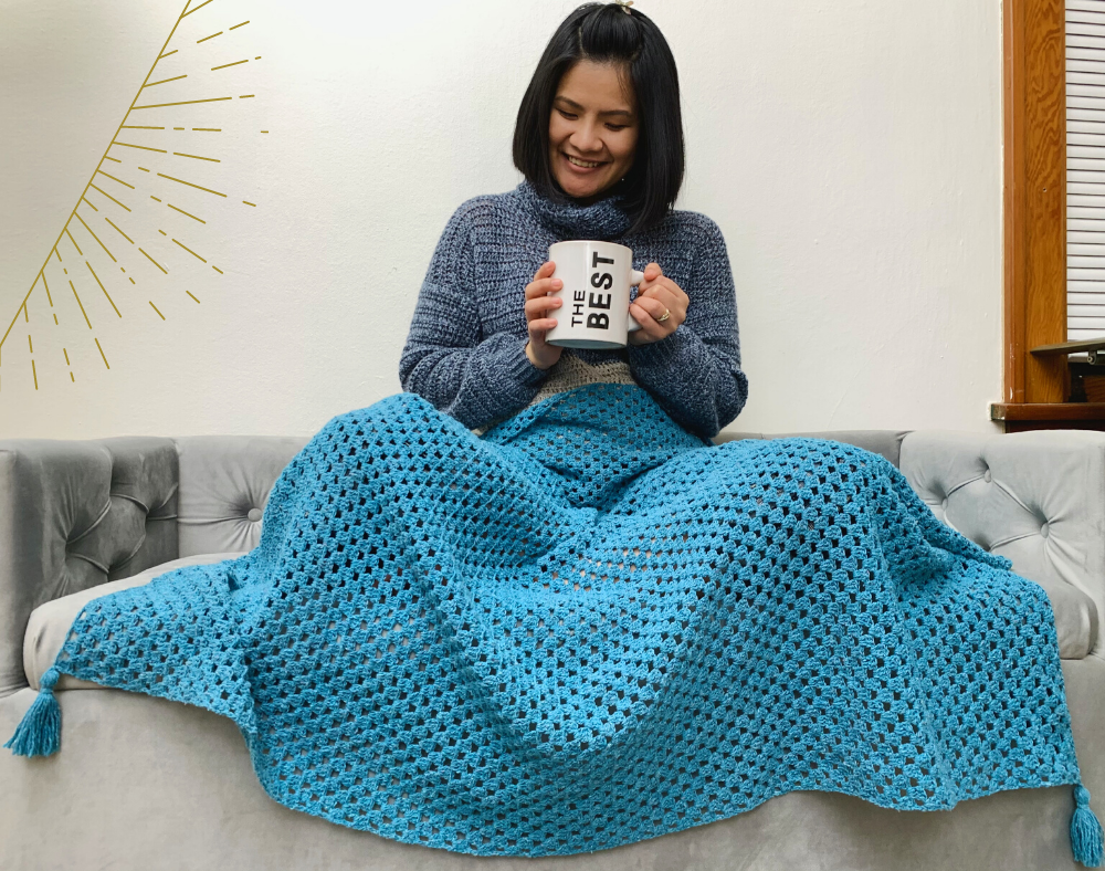 finished blanket from the free crochet blanket pattern by knitcroaddict